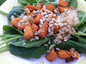 Roasted Butternut squash pine nuts and quinoa on spinach