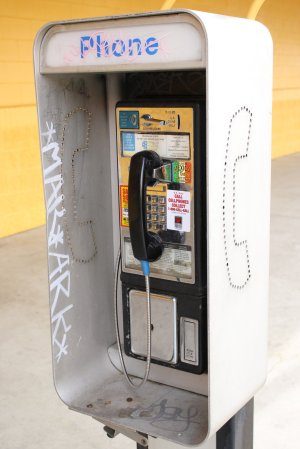 pay-phone-booth-with-grafitti